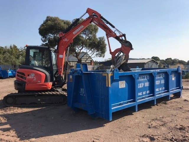 Large Skip with heavy moving equipment